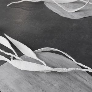 So Heavy I Fell Thru The Earth II (detail) - wire, cardboard, plaster bandage; fabric dye on paper
